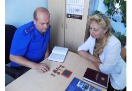 В Лиде следователи вернули родственникам украденные награды участника ВОВ
